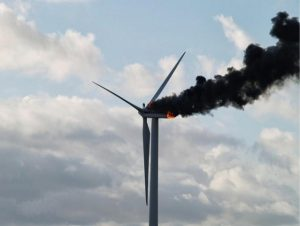 Two-Engineers-Hugging-Atop-A-Burning-Turbine-Before-They-Died-600x451